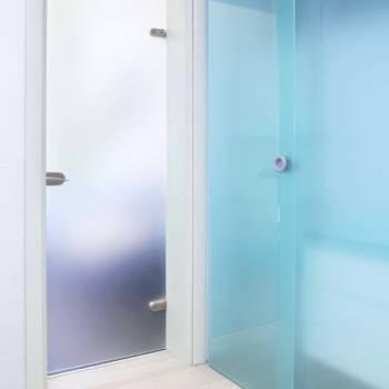 Blue glass door inside modern interior corridor